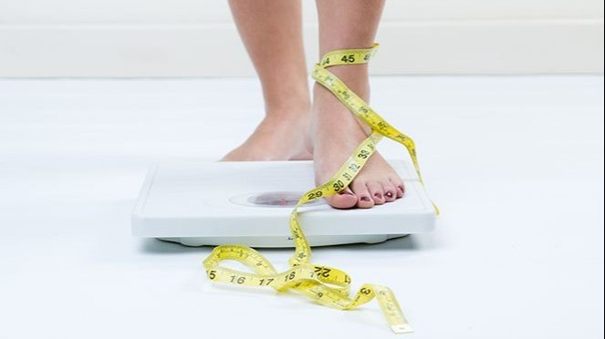 Ilustrasi timbangan berat badan.