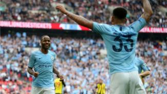 Raheem Sterling dan Gabriel Jesus merayakan gol Manchester City
