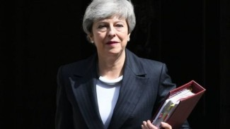 Theresa May akan tetap menjabat sebagai perdana menteri sampai ketua baru Partai Konservatif dipilih. - PA