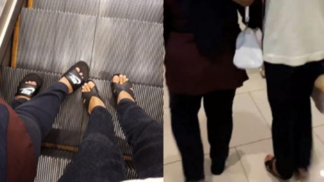Pria bertukar sandal dengan ibunya