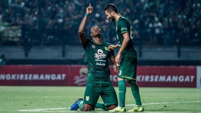 Striker Persebaya Surabaya, Amido Balde bersama Manuchekhr Dzalilov