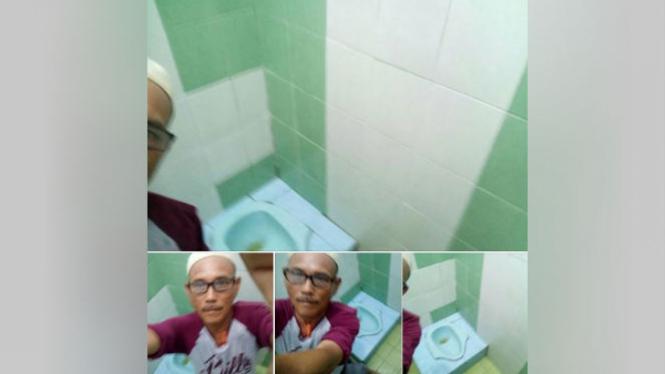 Pria trekunci di dalam toilet.