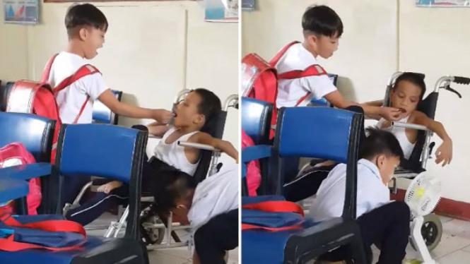 Dua siswa membantu temannya yang disabilitas