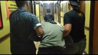 Penjambret sadis ditangkap di Garut, Jawa Barat, Minggu, 21 Juli 2019.