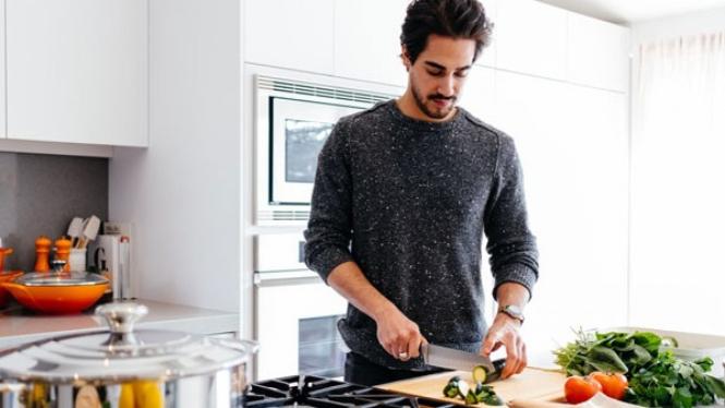 Ilustrasi pria memasak