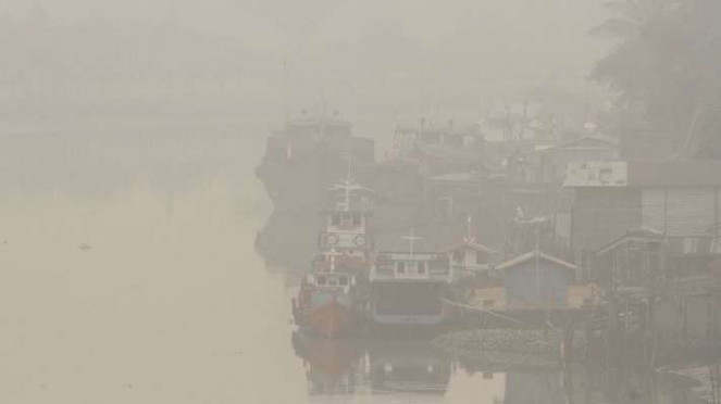Kabut asap ganggu masyarakat Pekanbaru Riau Jumat 13 September 2019