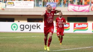 Pemain Persija Jakarta, Marko Simic melakukan selebrasi.
