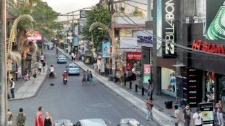 Traffic passes along Legian Street in Kuta, Bali.