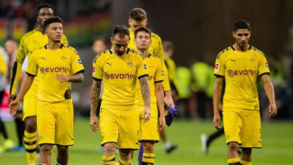 Ekspresi kecewa para pemain Borussia Dortmund usai gagal menang