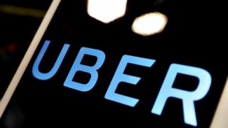 PHK Ribuan Karyawan dalam 2 Bulan, Ada Apa dengan Bisnis Raksasa Uber?. (FOTO: Reuters/Tyrone Siu)