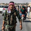 The Syrian regime is moving towards the Turkish border after Damascus reached a deal with Kurdish forces - AFP