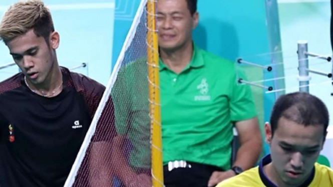 Duo Pebulutangkis Firman Abdul Kholik vs Sittikom Thamassin.