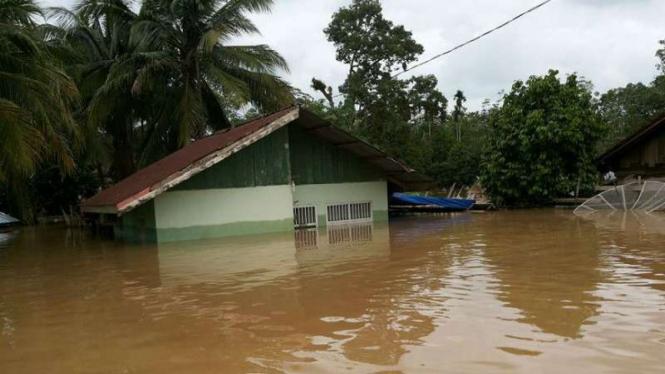Banjir di Jambi akibat meluapnya sungai Tebo di Jambi.