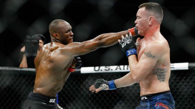 Juara kelas welter UFC, Kamaru Usman, saat hajar Colby Covington