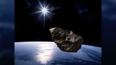 Asteroid mendekati Bumi.