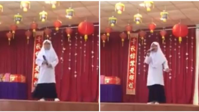 Gadis berhijab tampil di perayaan Imlek.