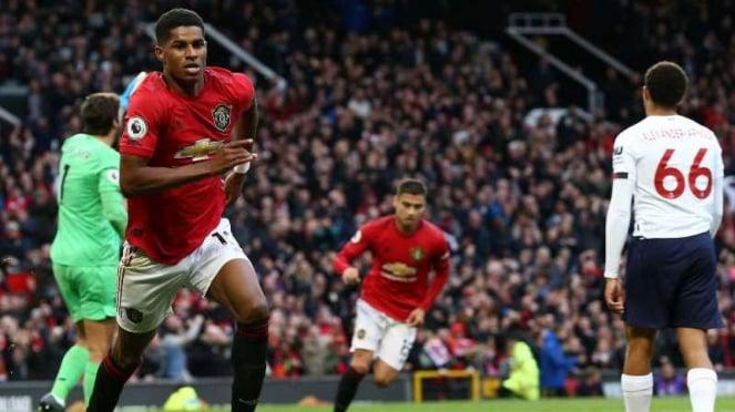 Penyerang Manchester United, Marcus Rashford, melakukan selebrasi