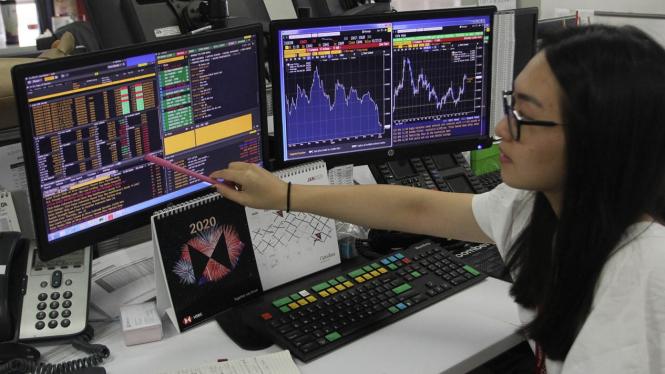 Layar monitor pergerakan saham dan IHSG