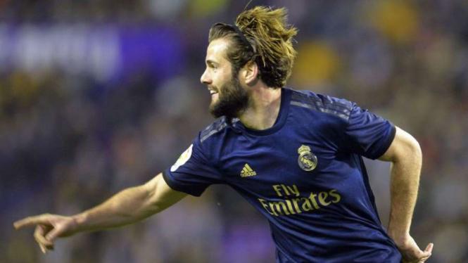 Bek Real Madrid, Nacho rayakan gol.