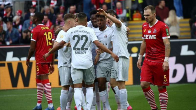 Para pemain Bayern Munich merayakan gol Robert Lewandowski