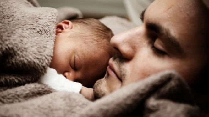 Ilustrasi ayah dan bayi.