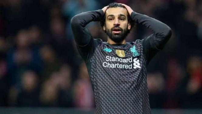Ekspresi kecewa bintang Liverpool. Mohamed Salah, usai kalah dari Atletico Madri