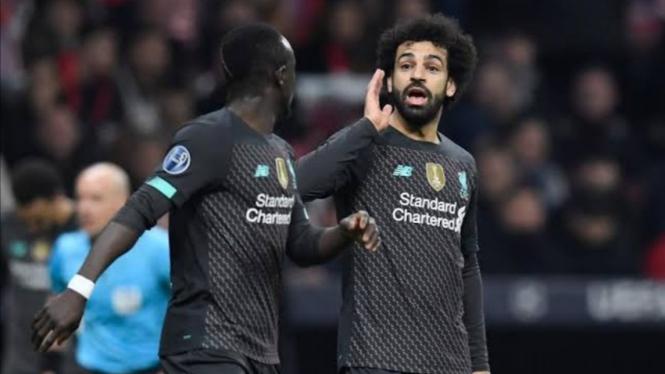 Penyerang Liverpool, Sadio Mane dan Mohamed Salah.