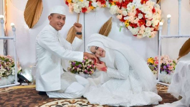 Brigadir T Murizal Saputra bersama istrinya, Maya Karmila.