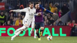 Sergi Ramos berusaha keras hentikan Lionel Messi