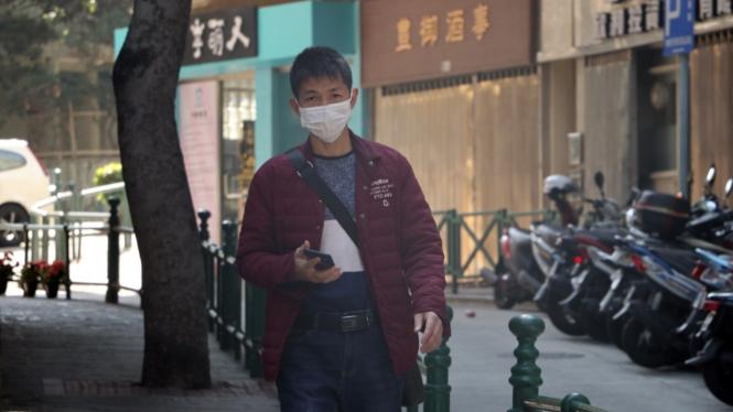 Pakai masker mencegah Virus Corona.