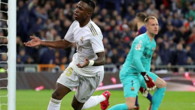 Striker Real Madrid, Vinicius Junior rayakan gol.