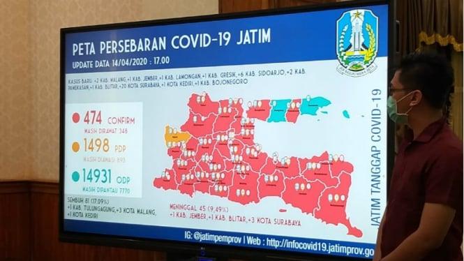 Peta persebaran dan grafik penularan Covid-19 di Jawa Timur.
