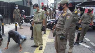 Hukuman Bagi Masyarakat Tidak Pakai Masker Saat PSBB