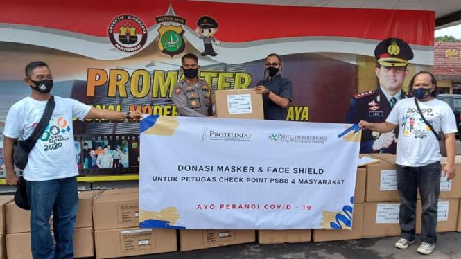 Bantuan masker untuk dibagikan di lokasi check point.