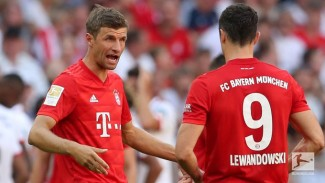 Pemain Bayern Munich, Thomas Mueller dan Robert Lewandowski.