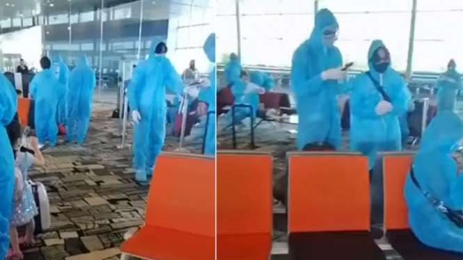 Penumpang asal Vietnam gunakan APD di Bandara Changi, Singapura.
