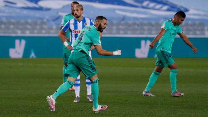 Bomber Real Madrid, Karim Benzema, merayakan gol