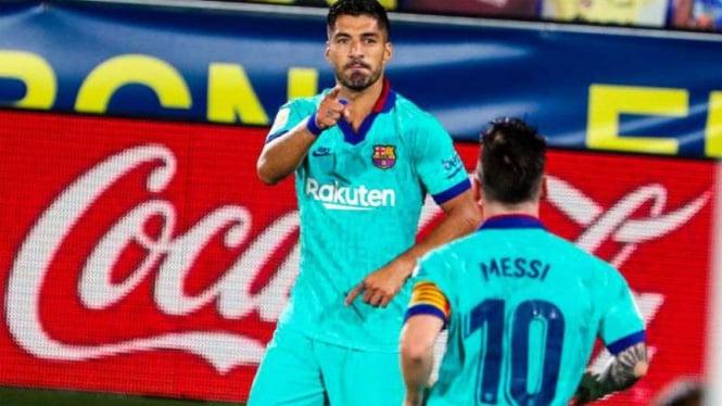 Pemain Barcelona, Luis Suarez dan Lionel Messi.