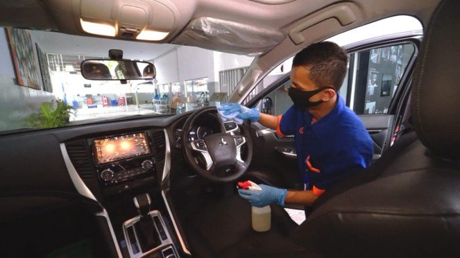 Ilustrasi pelayanan di bengkel resmi Mitsubishi di fase New Normal