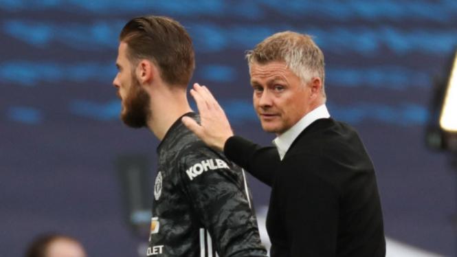 Manajer Manchester United, Ole Gunnar Solskjaer, dan David De Gea