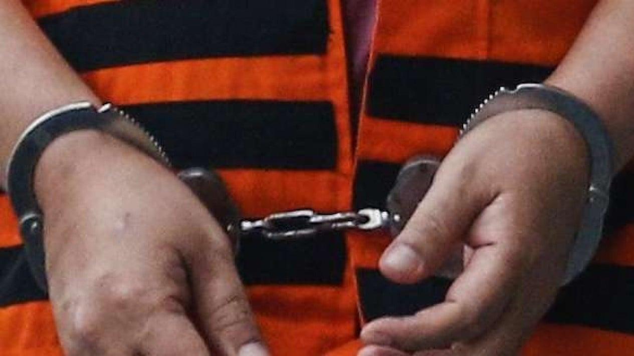 Ilustrasi tersangka kasus kejahatan diborgol