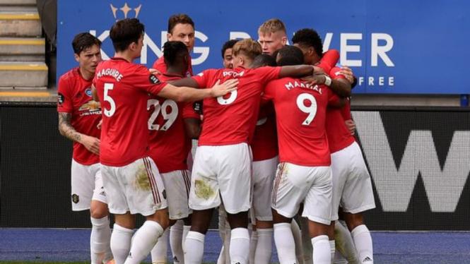 Selebrasi para pemain Manchester United usai lolos ke Liga Champions