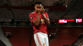 Gelandang Manchester United, Jesse Lingard, merayakan gol