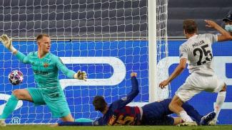 Thomas Mueller saat membobol gawang Barcelona