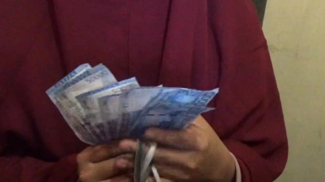Uang palsu (foto ilustrasi).
