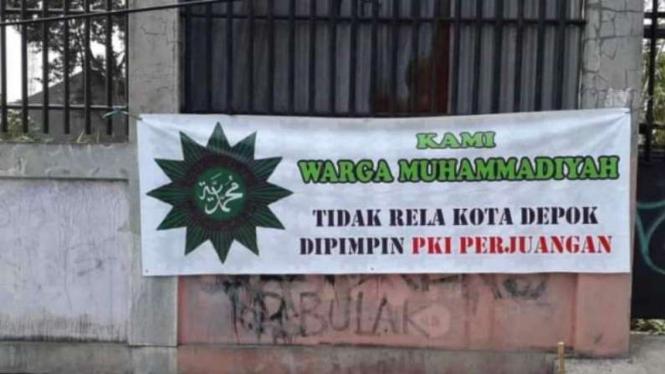 Spanduk provokatif yang mencatut nama Muhammadiyah.