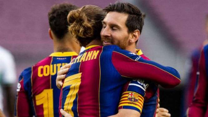 Pemain Barcelona, Antoine Griezmann dan Lionel Messi.