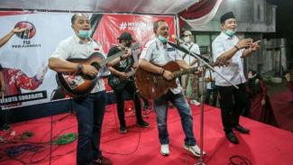 Risma Jadi Jurkam, Bikin Lagu Eri-Armudji Gandeng Musikus Jalanan