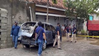 Lokasi penemuan mayat di dalam mobil terbakar