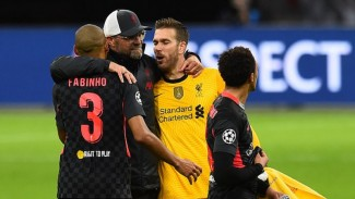 Manajer Liverpool, Juergen Klopp, bersama Fabinho dan Adrian